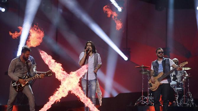 "Dorians of Armenia perform their song ""Lonely Plant"" during a rehearsal for the final of the Eurovision Song Contest at the Malmo Arena in Malmo, Sweden, Friday, May 17, 2013. The contest is run by European television broadcasters with the event being held in Sweden as they won the competition in 2012, the final will be held in Malmo on May 18. (AP Photo/Alastair Grant)"