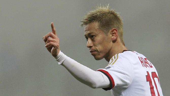 AC Milan's Honda gestures during their Italian Serie A soccer match against Sassuolo in Reggio Emilia