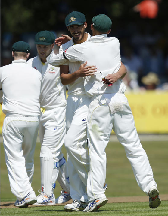 CRIC: Australia's Mitchell Starc celebrates taking the wicket of Essex's Thomas Moore (not pictured)