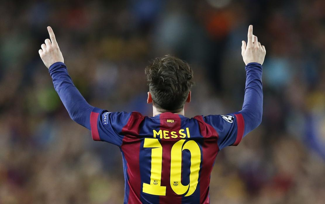 Football: Barcelona's Lionel Messi celebrates scoring their first goal