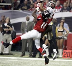 Falcons' Jones battles Buccaneers' Jackson for a pass before scoring a touchdown after the catch in their NFL football game in Atlanta