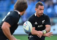 All Blacks' fly-half Aaron Cruden passes the ball during their rugby union Test match between Italy and New Zealand at the Olympic Stadium in Rome, on November 17. All Blacks won 42-10