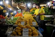 A vendor arranges fruit for sale at a market in Manila on March 27, 2013. The Philippines won its first investment-grade credit rating in a move President Benigno Aquino hailed as proof his country was no longer Asia's economic backwater