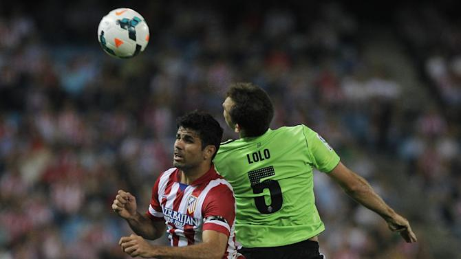 Atletico de Madrid's Diego Costa from Brazil, left, in action with Osasuna's Lolo, right, during a Spanish La Liga soccer match at the Vicente Calderon stadium in Madrid, Spain, Tuesday, Sept. 24, 2013