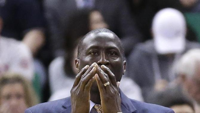 Utah Jazz head coach Tyrone Corbin reacts to a call in the second quarter during an NBA basketball game against the Los Angeles Clippers, Friday, March 14, 2014, in Salt Lake City. The Clippers won 96-87