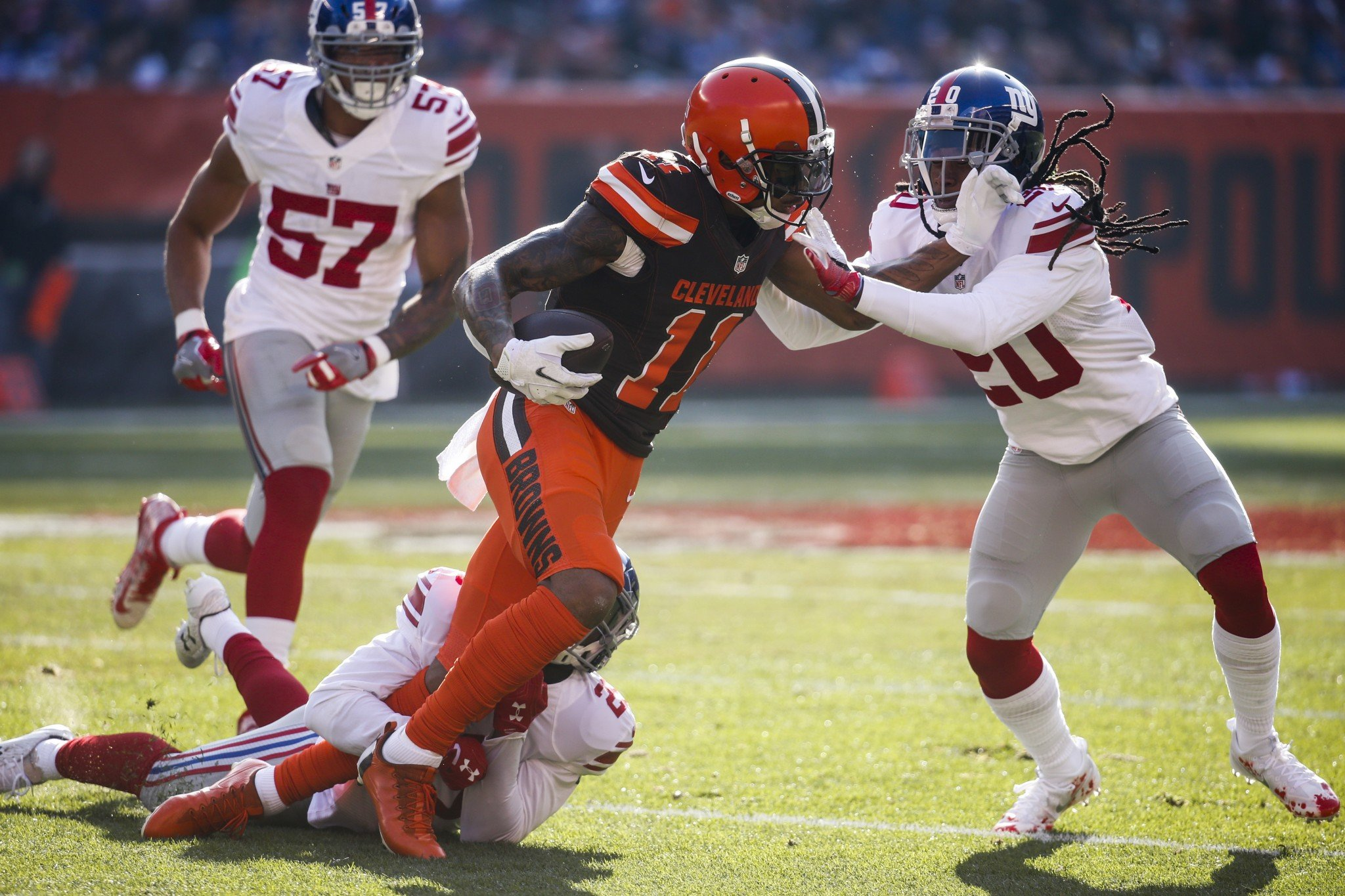 Fighting for yards: Cleveland's Terrelle Pryor tries to stiff-arm New York's Janoris Jenkins. (AP)