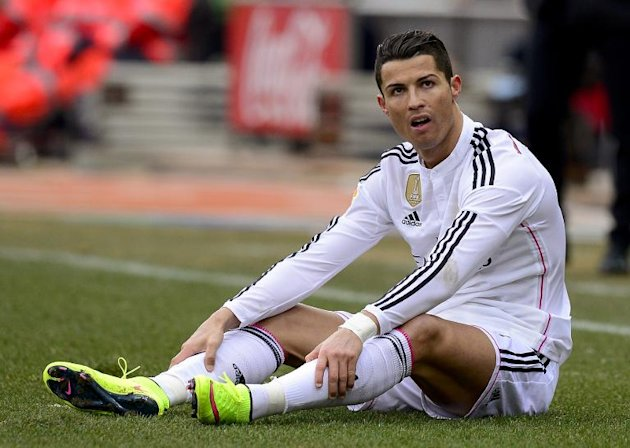Real Madrid's Cristiano Ronaldo looks dejected during the Spanish league match against Atletico Madrid at the Vicente Calderon stadium on February 7, 2015