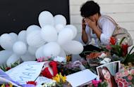 A relative of a victim weeps in front of the Kiss nightclub in Santa Maria, southern Brazil, on January 29, 2013. A private association has filed a lawsuit in the wake of a fatal fire at the club, demanding three million reais ($1.5 million) for each family of the 239 victims, a lawyer said