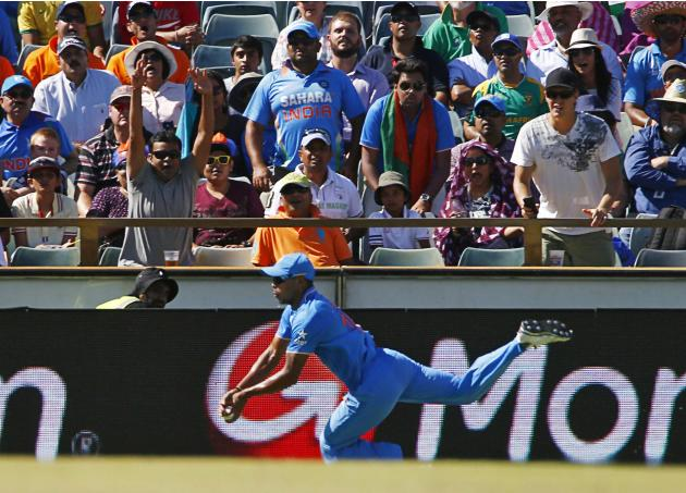 India's Umesh Yadav drops a catch off West Indies batsman Chris Gayle at the boundary during their Cricket World Cup match in Perth