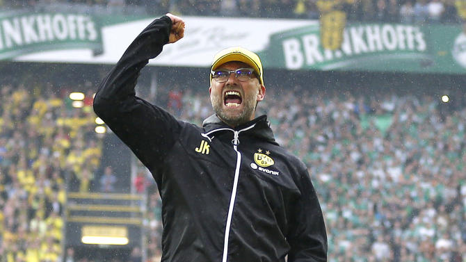 Dortmund's head coach Juergen Klopp says farewell to supporters after  the German first division Bundesliga soccer match between BvB Borussia Dortmund  and Werder Bremen in Dortmund, Germany, Saturday, May 23, 2015. (AP Photo/Frank Augstein)