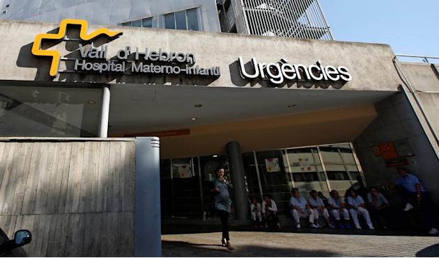 People are seen at the entrance of the maternity emergency unit of the Vall d'Hebron Hospital in Barcelona