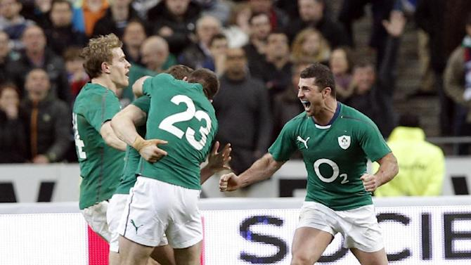 Ireland's rugby team players celebrate defeating France and winning the Six Nations Rugby Union tournament at the Stade de France stadium, in Saint Denis, outside Paris, Saturday, March 15, 2014
