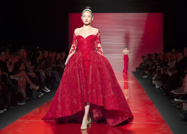 A model walks the runway in the Mikael D Fall 2015 show during Toronto fashion week in Toronto on Friday, March 27, 2015.  (AP Photo/The Canadian Press, Frank Gunn)