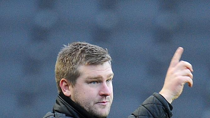 MK Dons manager Karl Robinson was goaded by Brentford fans after their clash