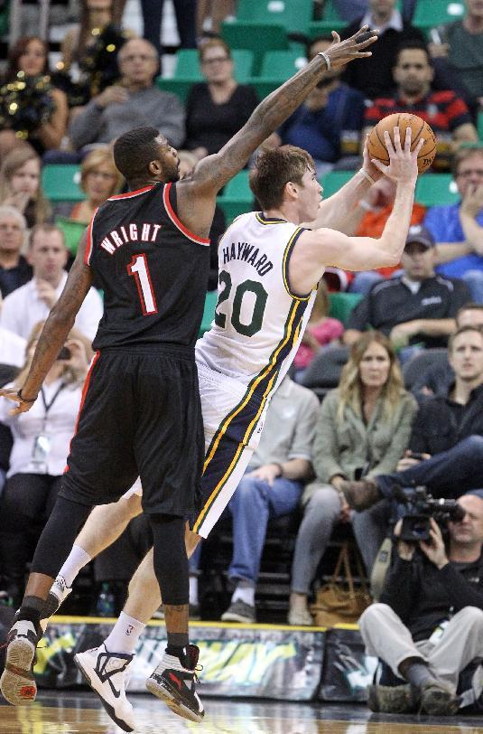 Portland Trail Blazers' Dorell Wright (1) defends Utah Jazz's Gordon Hayward (20) in the first quarter of an NBA preseason basketball game Wednesday, Oct. 16, 2013, in Salt Lake City