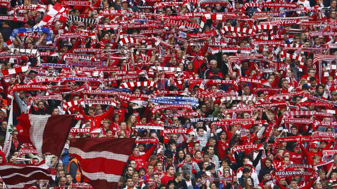Supporters of Bayern Munich party in the stands before the German first division Bundesliga soccer match against Borussia Dortmund in Munich