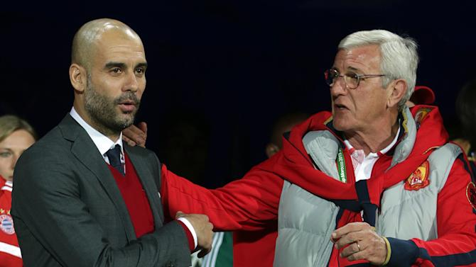 Bayern head coach Pep Guardiola of Spain, left, and Guangzhou Evergrande's coach Marcello Lippi of Italy arrive for their semifinal soccer match between Guangzhou Evergrande FC and FC Bayern Munich at the Club World Cup soccer tournament in Agadir, Morocco, Tuesday, Dec. 17, 2013