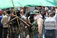 Image from Syrian opposition's Shaam News Network shows an anti-regime demonstration in Silkin, Syria, May 26. China on Wednesday restated its opposition to military intervention in Syria, as Russia sought to halt fresh UN Security Council action after a massacre of civilians sparked global fury. AFP is using pictures from alternative sources as it was not authorised to cover this event