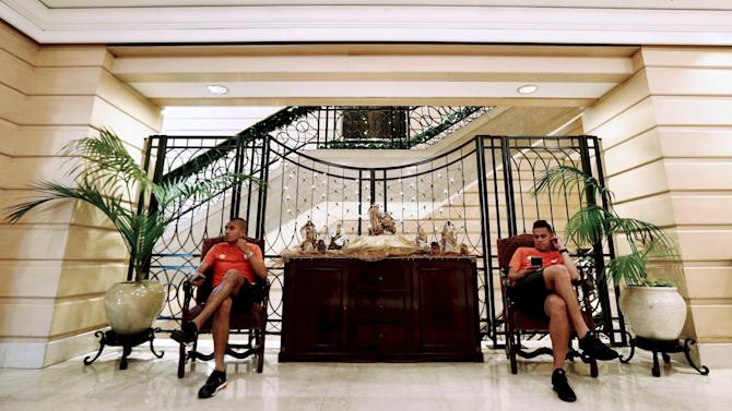 Otalvaro and Anchico of Independiente Santa Fe, sit in the lobby at their hotel ahead of their Copa Sudamericana final soccer match against Argentina's Huracan in Buenos Aires