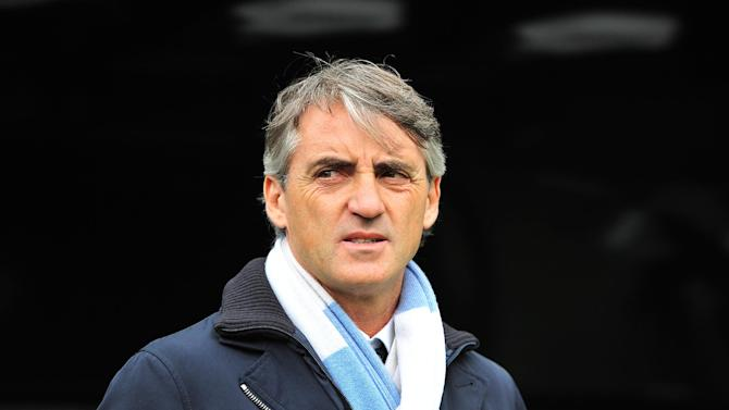 Roberto Mancini was coy about Manchester City's transfer targets at a press conference