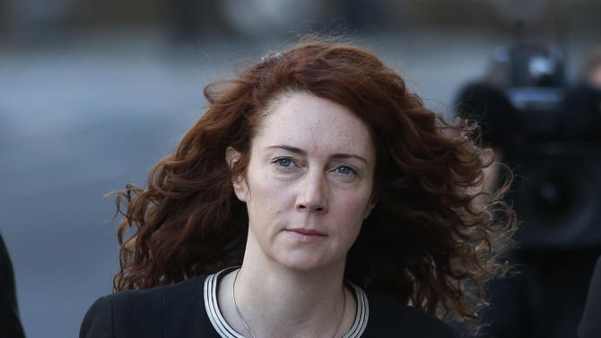 Former News of the World editor Rebekah Brooks arrives at Central Criminal Court in London, Tuesday, Oct. 29, 2013. Once one of the most powerful people in the British media, Brooks, a senior executive for media mogul Rupert Murdoch and associate of Prime Minister David Cameron, is accused on charges of hacking phones and bribing officials while at the now-shuttered Murdoch tabloid. (AP Photo/Lefteris Pitarakis)