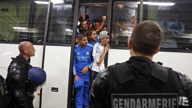 French riot gendarmes secure the arrival of Olympique Marseille's supporters before the French Ligue 1 soccer match between Nice and Olympique Marseille at Allianz Riviera stadium in Nice