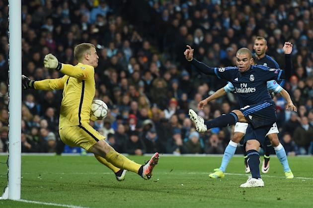 Manchester City's goalkeeper Joe Hart makes a save from a shot by Real Madrid's Pepe during the match in Manchester, on April 26, 2016