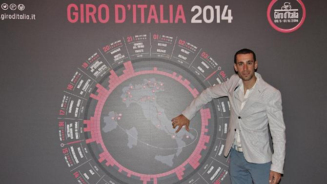 Vincenzo Nibali, of Italy, winner of the 2013's Giro D' Italia cycling race, poses for photographers in front of a poster showing the 2014 Giro's stages, during the official presentation, in Milan, Monday, Oct. 7, 2013. Next year's Giro d'Italia will honor the 10th anniversary of Marco Pantani's death with several stages dedicated to the Italian climber. Having already announced that the race will start May 9 with three stages in Northern Ireland and Ireland and finish in Trieste on June 1, the rest of the route was unveiled Monday. Stage 8 from Foligno to Montecupiolo will include the Carpegna climb where Pantani used to train, and uphill finishes in Oropa (stage 14) and Montecampione (stage 15) will recall two of his well-known victories in the race