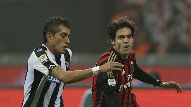 AC Milan Brazilian forward Ricardo Kaka', right, challenges for the ball with Udinese midfielder Maximiliano Roberto Pereyra of Argentina during a Serie A soccer match between AC Milan and Udinese, at the San Siro stadium in Milan, Italy, Saturday, Oct. 19, 2013
