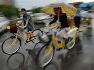 "Women ride bikes during the third ""SkirtBike"" in Bucharest on June 2, 2013"