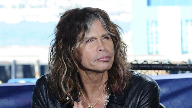 "This Oct. 10, 2011 photo released by Fox shows ""American Idol"" judge Steven Tyler during auditions for the singing competition series in San Diego. Tyler, who quit the show, admits he liked the paychecks, but had a love-hate relationship with the show. In an interview with Rolling Stone, Tyler says the series is ""not my cup of tea.""  Tyler tells the magazine he took the job because it was a good way to pass the time while he and his band mates worked out their behind-the-scenes conflicts. He also says he didn't have it in him to be negative to contestants. (AP Photo/Fox, Michael Becker)"