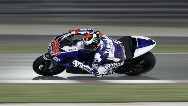 Motorcycling - Lorenzo pips Rossi as Marquez crashes