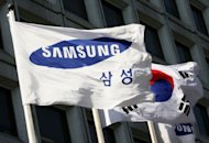 A Samsung Group flag flutters alongside a national flag on the wall of the group's headquarters in Seoul. Samsung Engineering said on Tuesday it had won a $2.1 billion order to build a power plant in Kazakhstan as the central Asian nation bids to meet growing energy demand
