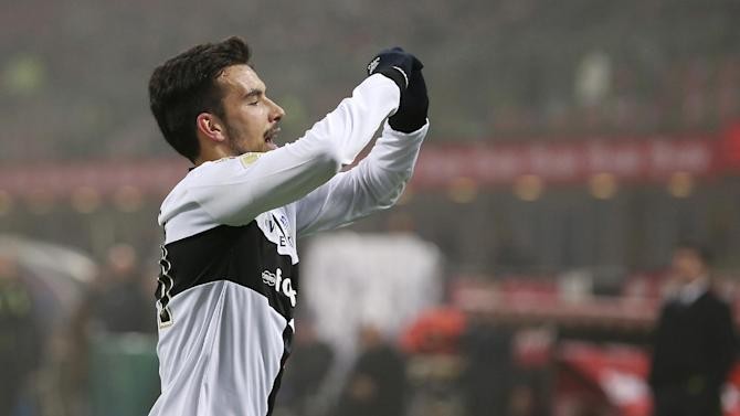 Parma forward Nicola Sansone celebrates after scoring during the Serie A soccer match between Inter Milan and Parma at the San Siro stadium in Milan, Italy, Sunday, Dec. 8, 2013