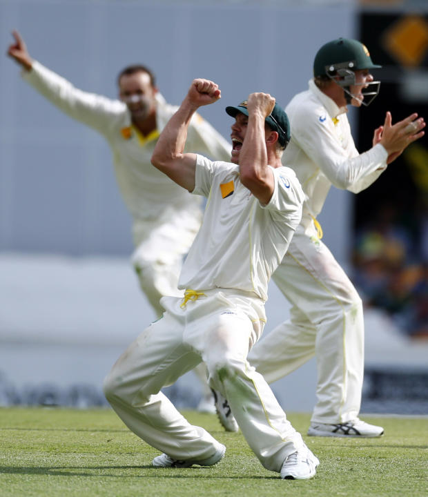 Australia's Warner celebrates after he took the catch to dismiss England's Prior during the fourth day's play of the first Ashes cricket test match in Brisbane