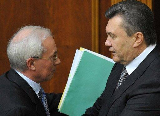 Ukrainian President Viktor Yanukovych (right) greets Prime Minister Mykola Azarov after a 2010 parliamentary session in Kiev. Yanukovych has accepted the resignation of Azarov and the entire government.