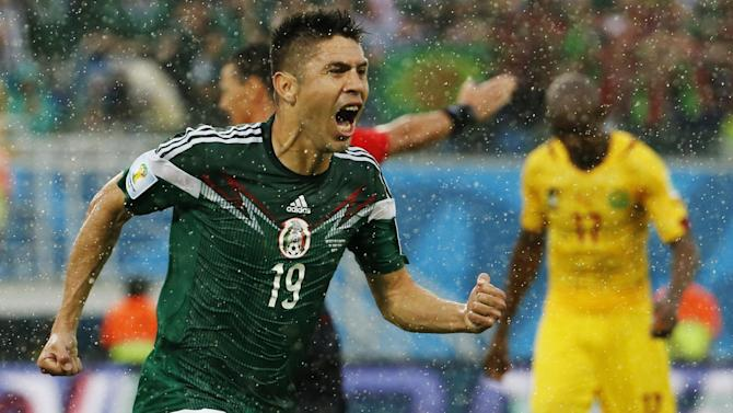 World Cup - Mexico overcome referee gaffes to down Cameroon