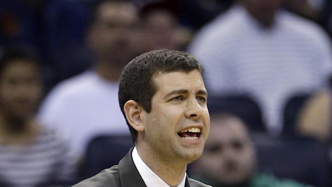 Boston Celtics head coach Brad Stevens calls out to his players during the second half of an NBA basketball game against the Orlando Magic in Orlando, Fla., Sunday, Jan. 19, 2014. Orlando won 93-91