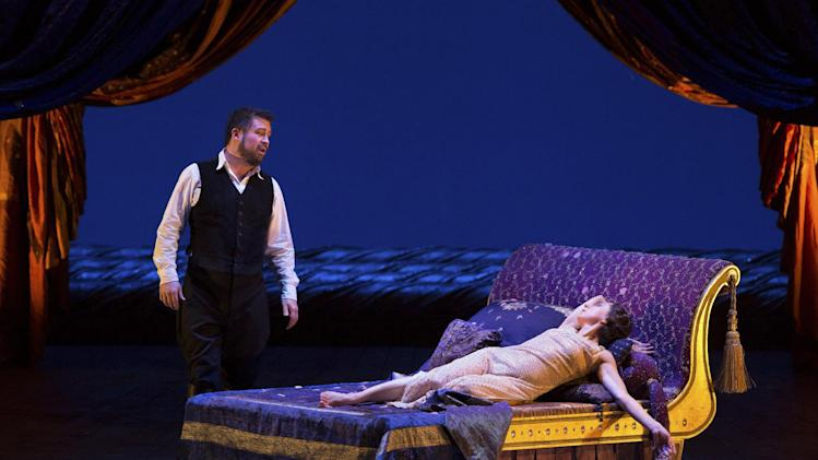 "In this March 27, 2013 photo provided by the Metropolitan Opera, Natalie Dessay as Cleopatra, right, and David Daniels as Julius Caesar perform during a rehearsal of Handel's ""Giulio Cesare."" (AP Photo/ Metropolitan Opera, Marty Sohl)"