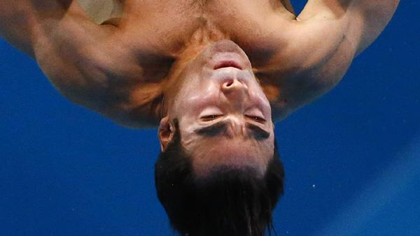 Canada's Alexandre Despatie performs a dive during the men's 3m springboard final at the London 2012 Olympic Games at the Aquatics Centre
