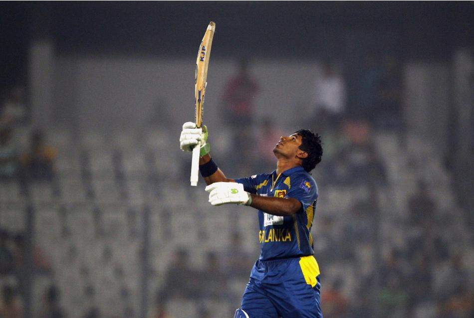 Sri Lanka's Kusal Perera celebrates after scoring a century on the third one day international cricket match against Bangladesh in Dhaka, Bangladesh, Saturday, Feb. 22, 2014. Sri Lanka won by 6 wicket