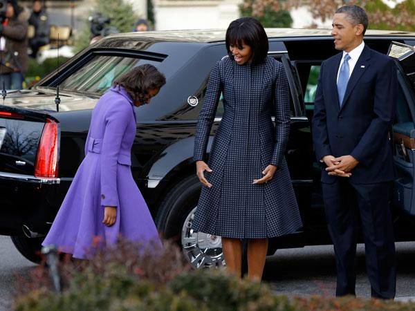 Michelle Obama joins her husband, President Barack Obama and her daughters Sasha and Malia, for the Inauguration Day ceremonies on Jan. 21, 2013. Fittingly, the First Lady wears a blue Thom Browne coat on Blue Monday! (AP Photo/Jacquelyn Martin)