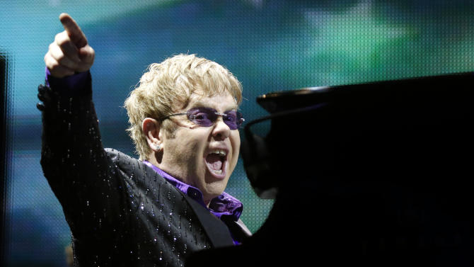 FILE - This June 30, 2012 file photo shows British pop star Elton John performing during the Euro 2012 soccer championship in Kiev, Ukraine. The Songwriters Hall of Fame announced Tuesday, April 2, 2013, that Elton John and Bernie Taupin will be the 2013 recipients of the esteemed Johnny Mercer Award. The 44th Annual Induction and Awards Dinner is slated for Thursday, June 13 in New York.  (AP Photo/Efrem Lukatsky, file)