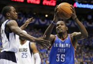 Dallas Mavericks' Rodrigue Beaubois (3), of Guadeloupe, defends against a drive to the basket by Oklahoma City Thunder's Kevin Durant (35) in the first half of Game 3 in the first-round of the NBA basketball playoffs series, Thursday, May 3, 2012, in Dallas. (AP Photo/Tony Gutierrez)