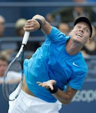 Tomas Berdych of the Czech Republic hits a serve to Nicolas Almagro of Spain during their men's singles match at the 2012 US Open tennis tournament in New York. Berdych won 7-6 (7/4), 6-4, 6-1