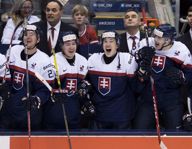 Slovakia players react after defeating Sweden during the third-place game at the hockey World Junior Championship in Toronto on Monday, Jan. 5, 2015. (AP Photo/The Canadian Press, Nathan Denette)