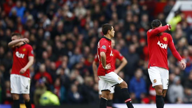 Manchester United's Phil Jones, Javier Hernandez and Robin van Persie react during their English Premier League soccer match against Newcastle United at Old Trafford in Manchester