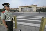A paramilitary policeman stands guard at Tiananmen Square opposite the Great Hall of the People in Beijing. China has increasingly become a focus of Republican attacks with Mitt Romney vowing a harder line on issues including trade, human rights and the military balance