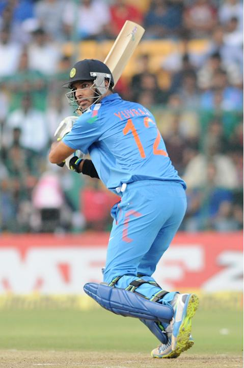 Indian player Yuvraj Singh in action during the 7th ODI between India and Australia played at Chinnaswamy Stadium in Bangalore on Nov.2, 2013. (Photo: IANS)