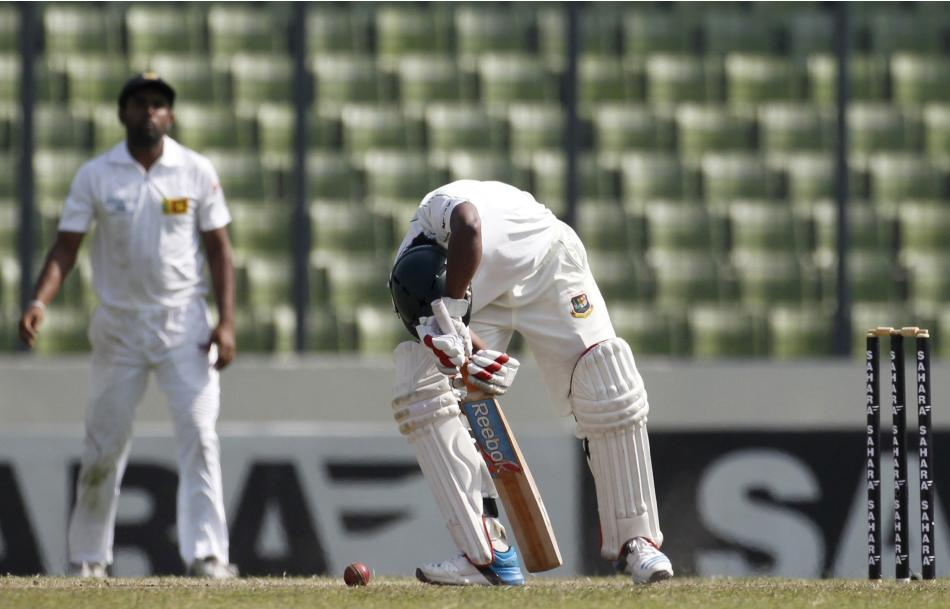 Bangladesh's Hossain tries to play a ball against Sri Lanka during their fourth day of their first test cricket match of the series in Dhaka.